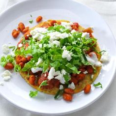 Pinto Bean Tostadas Recipe -Ready-to-go pinto beans and crispy corn tortillas prove how easy it is to make a healthy meal. Chili powder kicks up the fun, making this a popular pick for vegetarians and meat eaters alike. —Lily Julow, Lawrenceville, Georgia
