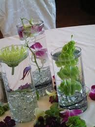 Chinese fighting fish centerpieces with orchids :)