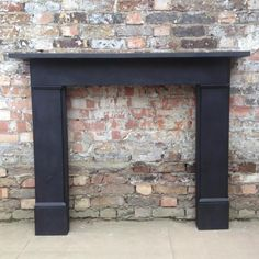 Reclaimed black slate fireplace surround