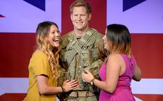 Helen Smith and Lucy Jenner pose beside the new wax figure of Prince Harry being displayed at Madame Tussauds in central London in celebration of his upcoming 30th birthday. Picture: Anthony Devlin/PA