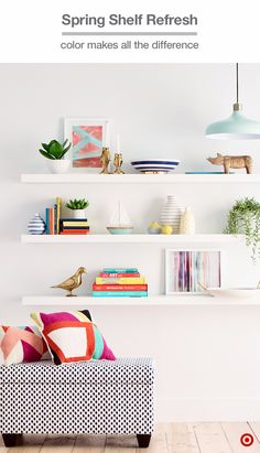 A geometric throw pillow can inspire your spring shelf update—and look great styled nearby, too. Just a few add-ons—like colorful striped bowls and vases—gold animal figurines and fresh plants, and your white shelves become so much more. Pick your favorite pieces and arrange items and books in vignettes to show off your personal style.