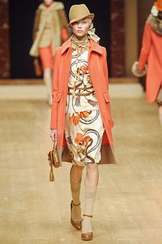 Blugirl-once again the orange coat in another collection. Love the tassel pattern of the dress.Fall Milan 2011