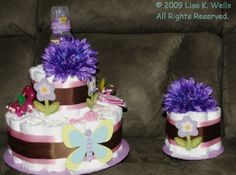 Two tier and mini diaper cake set, girl theme.  See http://www.lisasgiftcakes.com for more info or to order!