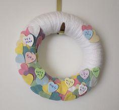 Valentine Day Wreath, Conversation Hearts Wreath, Felt and Yarn Wreath, Pastel Wreath, 12 inch size. $45.00, via Etsy.