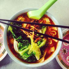 My favorite dish in Kuala Lumpur, Malaysia. Spicy soup with cabbage, fish cake, dried fish, & pork. savetheflav.blogspot.com