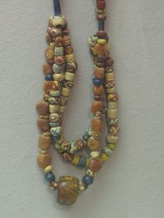 Anglo-Saxon Beads, Dover Museum  Anglo-Saxon glass bead necklace from Eastry House in the Dover Museum, Kent, England.