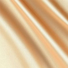 Silky Satin Charmeuse Solid Gold from @fabricdotcom  This very lightweight and ultra soft charmeuse satin has a beautiful hand and drape. It is appropriate for blouses, dresses and skirts - especially on the bias. It is also perfect for flirty lingerie.