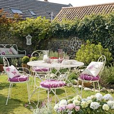 Pretty country garden  Cream metal furniture is key to a country-garden look – it's timeless and works well in small spaces. Add plump cushions in grape, pink and white, set out matching glassware, then sit back and soak up the sunshine.