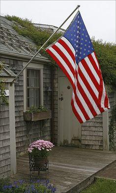 The American Flag on a coastal porch.
