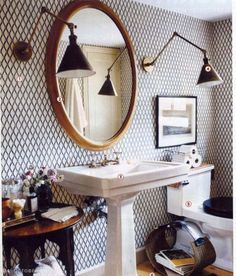 Rita Konig bathroom from Domino  love the lights and the tile