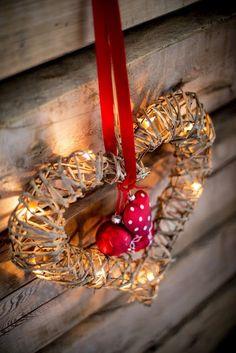 .Slip battery powered lights in wicker wreaths.