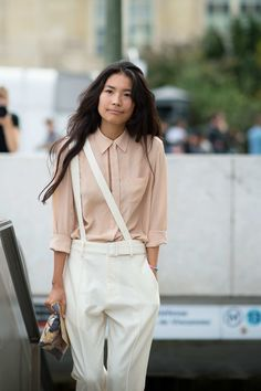Suspenders Girl Here's a handy styling trick to try with suspenders: Instead of wearing them the traditional way, have them drape diagonally across the body.  Photo: YoungJun Koo/I'M KOO