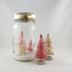 Mason jar snow globes with DIY hand dyed bottle brush trees.