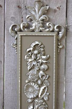 Upcycled wall plaques hand painted in olive green and accented in ivory with a protective coating. Manufactured by Syroco in 1970. One depicts flowers and the other, fruits and vegetables. There are h