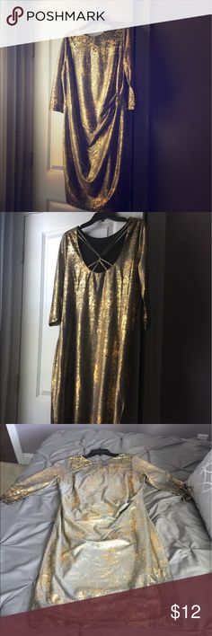 Stunner Alert! Silver and Gold Vegas Dress! This dress is awesome!!! Silver and gold and a hint of shine. Cut and gathered to flatter in all the right spots! Very light weight. Purchased this bad girl for New Years but snow and wind prevented me from ever wearing her. Perfect for a GNO or trip to Vegas! Cato Dresses