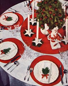 A Tiny Christmas Tree! 1944 Table decor compliments of House Beautiful. Look at Santa...he's having a grand time!! :)