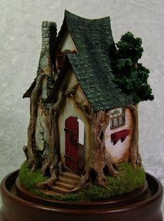Acorn Wood Cottage Kit 1/4 scale-Jill Castoral A doll house that I'd use for some fairies I know.