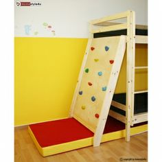 Climbing wall with fall protection for bunk bed cots