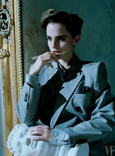 "Emma Watson with sculpture in ""Rebel Belle"" for Vanity Fair, March 2017. Photograph by Tim Walker. Watson in a jacket by Balenciaga; shirt and pocket-square by Anderson & Sheppard."