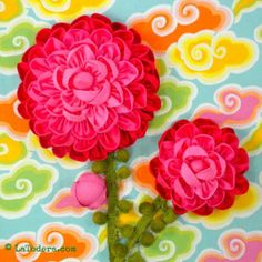 Kanzashi flower Camellias on a fabric flower embellished mini quilt. Shown- 3 sizes of camellia fabric flowers included in pattern.