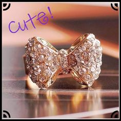 SOLD in Bundle!  NWOT, Beautiful 9K Yellow Gold Filled with AAA CZ, Size 8 Bow Ring! Ring is adjustable- see pic! Lots of Sparkle, Beautiful Bling! Please ask any questions! Price Firm unless Bundled!-- Please ask for Bundle Listings & Discounts!! ❌Trades ❌PP Jewelry Rings