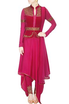 This set features a magenta peplum jacket in velvet and crepe with gold zardozi embroidered neckline, belt, hem and sleeves. It comes along with magenta crepe a