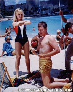 """Barbara and Larry on location in Hawaii while filming """"I Dream of Jeannie."""" This shot was taken between shots when Jeannie blinked a fur coat onto Major Nelson out on the beach. Barbara had to stand still and hold the position while wardrobe dressed Larry in the fur coat and reset the scene. -Team Eden"""