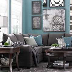 I love the chocolates, grays & teal combinations...cozy living room!