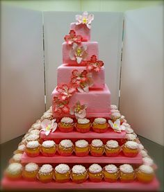 4-Tier with Cupcakes by Andria Chiander. this is my wedding cake but the colors will be black, white and hot pink