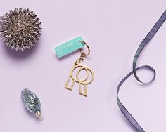 """DAY 3: Various Keytags & RINGLY We're getting you all keyed up: 25 of today's orders will include a Various Projects keytag and an exclusive Ringly """"R"""" keychain! #Ringly7Days"""