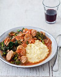 Spicy Italian sausage and broccoli rabe simmer in a flavorful tomato sauce. Served over a mound of creamy polenta, they make a ravishing, rustic Italian meal for a cold winter's night. If you like, pass grated Parmesan at the table.  Slideshow: Winter Comfort Food