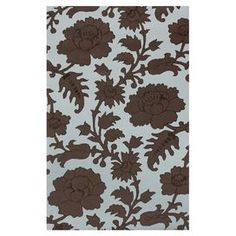 Add a spring to your step with this eye-catching rug, showcasing a contemporary floral motif and an on-trend palette.   Product: RugConstruction Material: 80% New Zealand wool and 20% viscoseColor: Blue and brownFeatures:  Hand-tuftedMade in India Note: Please be aware that actual colors may vary from those shown on your screen. Accent rugs may also not show the entire pattern that the corresponding area rugs have.
