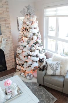 White and pink feathered, fluffy Christmas tree. Glam, bright white Christmas decor. Fluffy Christmas tree that looks like snow.