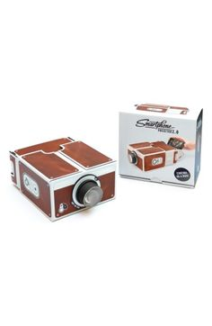$32 Luckies of London Smartphone Projector 2.0 at Nordstrom.com. An old-fashioned projector lets you share your favorite movies, TV shows and funny Internet clips without sacrificing your personal space, by displaying your screen on the wall or nearest smooth, flat surface at up to 8x magnification. Adding to the nostalgic value, the ingenious use of mirrors and reflective technology means that no batteries are required—just make sure your phone is fully charged, of c...