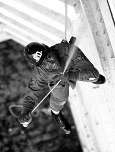 Firefighter training at Yokota, 1975 | Bob Wickley ©Stars and Stripes Yokota Air Base, Japan, January, 1975: A member of the 475th Civil Engineering Squadron's fire protection rescue team rappels down the side of a housing unit at Yokota Air Base. The team practiced procedures to be used in the event of a fire in the high-rise building about three times a month.