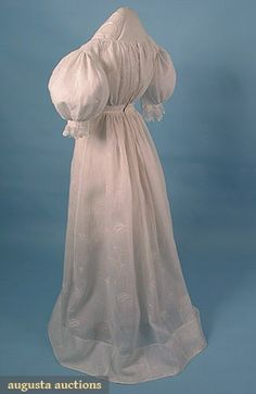 "COTTON WEDDING DRESS, c. 1825 1-piece mull dress, embroidered w/ bow-tied wheat sheaves & vines, B 32"", High W 22"", L 55"", (scattered small holes) good."