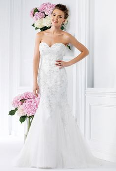 Brides: Jasmine Collection. Ivory tulle fit and flare gown with floral beaded bodice, sweetheart neckline and tulle skirt.