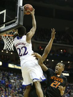 Kansas guard Andrew Wiggins gets up for a lob dunk over Oklahoma State forward Kamari Murphy during the second half on Thursday, March 13, 2014 at Sprint Center in Kansas City, Missouri. #KU