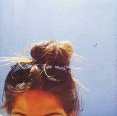 Messy bun, and shades.