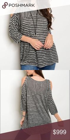 """NWT Cold Shoulder Black & Gray Tunic Top NWT.  Rayon/Polyester.  Very soft, 3/4 length cold shoulder sleeves, round neck, raw edge around neck and shoulders, side vents, black and gray striped tunic.  Approx measurements laying flat: SMALL chest 20"""", length 26"""" MEDIUM chest 21.5"""", length 28""""  LARGE chest 23"""", length 28"""".  I am a size 6 and 5'7"""" with a large chest, I would wear a medium only for the added length.  Otherwise, I would wear a small in this top. Tops Tunics"""