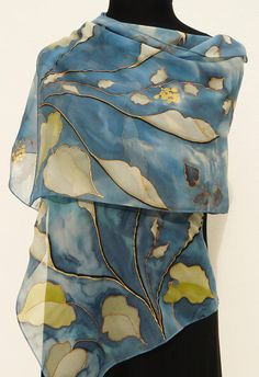 Navy chiffon silk scarf , hand painted with white Calla lilies flowers on navy and denim blue, grey background with vines. This luxurious kind of transparent natural silk is named crepe georgette. It drapes beautifully and is totally mat . The drawing of this handpainted floral wrap is made with metallic gold gutta : it is an elegant scarf for any occasion. Colors : white , navy , gray , very pale green , metallic gold gutta . Dyes : Non toxic steam set high quality French dyes . Size : 16 x…