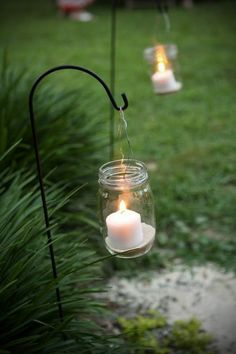 put in colored sand and flameless candles Blissful Whimsy Events: Hanging Mason Jar Candles DIY / North Carolina Wedding Planner Hanging Mason Jars, Mason Jar Candles, Mason Jar Lighting, Mason Jar Diy, Diy Candles, Flameless Candles, Mason Jar Candle Holders, Garden Candles, Yankee Candles