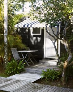Striped awning wi dow cover for back alartment The Bungalow. Xk #kellywearstler