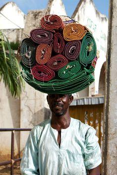 Man selling rugs. Kaduna, Nigeria.