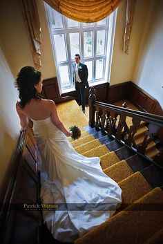 staircase photo – Sprowston Manor Wedding.  Austin, might be cute for dad to be waiting on the stairs for a pic like this