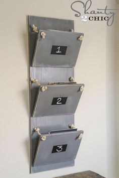 Break out your drill and basic construction skills to DIY this inventive faux-metal magazine rack. Whitney and Ashley of Shanty 2 Chic spray-painted wood in a satin granite color to mimic the look of aluminum and built the bins with hinges, cup hooks, and sisal rope. Chalkboard paint squares on the front of each bin serve as labels. Get the tutorial at Shanty 2 Chic.