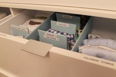 Good idea! Organized labeled drawer space for baby items.
