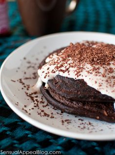 Peppermint Chocolate Mocha Protein Pancakes with a minty yogurt topping--healthy and delicious!