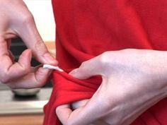 Get gum off of clothes by heating up some white vinegar and applying it to the gum to get it out.