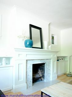 Beautiful built-in fireplace. Love the marble subway tile and the white wood work. | Marshall House Matters: Reveal: Fireplace & Built-ins